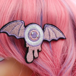 goth kawaii pastel winged eyeball clip
